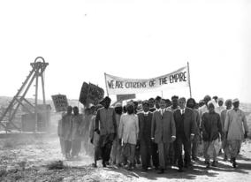 The young Gandhi (Ben Kingsley) leads his first protest march of striking Indian miners in South Africa.