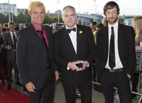 Huw Edwards (centre) arrives at the Awards, nominated in the presenter category