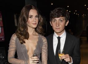 Craig Roberts, star of Submarine, at the Awards party with his guest