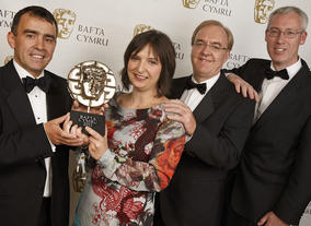 The BBC Wales team poses with their newly acquired BAFTA Cymru Award