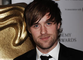 Jonas Armstrong, currently gracing the screen as the star of Robin Hood, arrives on the red carpet