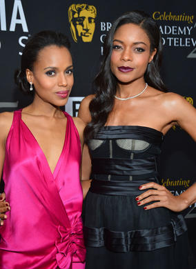 Actress Kerry Washington and Bond star Naomie Harris strike a red carpet pose.