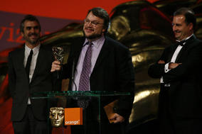 L-r: Alfonso Cuaron, Guillermo del Toro and Alvaro Augustin accept the Film Not in the English Language BAFTA for Pan's Labyrinth (BAFTA / Brian Ritchie).