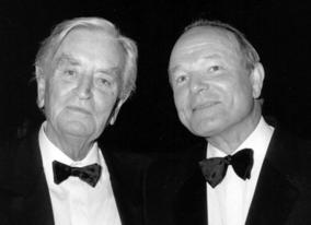 Sir David Lean with Sir Sydney Samuelson at a dinner held in honour of Sir David Lean, 1988, in Cannes.