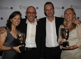 Winners of the Entertainment award for 'Election' with citation reader, Phil Cornwell.