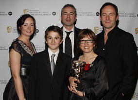 Winners of the Drama award for 'Rhestr Ndolig Wil (Wil's Christmas LIst)' with citation reader, Jason Isaacs.