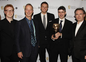 Representatives of the winner of Independent Production Company of the Year, Astley Baker Davies, with citation reader Jake Humphrey.