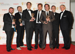 The Factual Series BAFTA went to the team behind Our War. They're pictured here with Apprentice and Countdown star Nick Hewer.