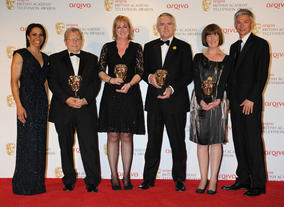 The Sport and Live Event BAFTA went to the team behind coverage of The Royal Wedding, including presenter Huw Edwards. They're pictured here alongside athletes Dame Kelly Holmes and Jonathan Edwards.