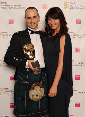 "Presenter Suzi Perry with Colin Blackwood of Electronic Arts. The jury described the game's sound as offering ""a dramatic and powerful sense of perspective and space."""