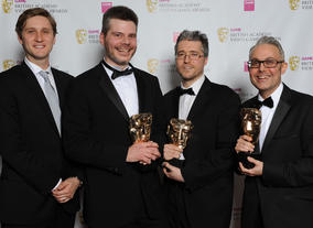 "Actor Aaron Staton with winners Kevin McDowell, Scott Pitkethly and Alan Blair. The jury praise the game's ""integration of turn-based and real-time mechanics."""