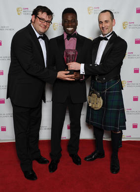 Presenter Ortis Deley (centre) with Colin Blackwood and Kevin Flynn from Electronic Arts. This game saw off stiff competition from nine other titles in the public vote.