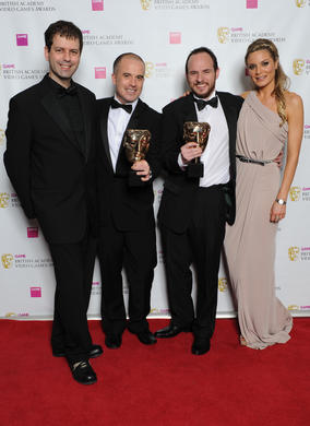 "Chris Kingsley (l) and Charlotte Jackson with the winning team behind Batman: Arkham City. The jury described the game as ""a delight to play and a challenge to master."""