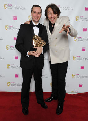 "Presenter Jonathan Ross with Josh Weier from Valve. The jury described the game as ""a blend of cerebral accessibility and nascent storytelling trumped only by excellent level design."""