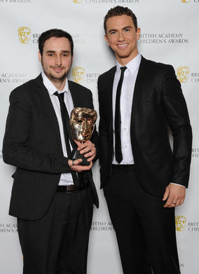 Presenter Richard Fleeshman with one of the winning Development Team members of LEGO Pirates of the Caribbean.
