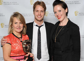 Presenter Sam Branson with the winners of Disney Channel animation Fish Hooks.