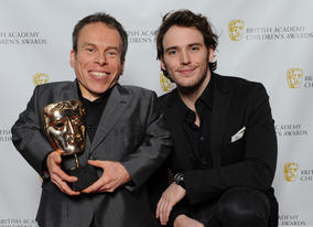 Harry Potter star Warwick Davies (Professor Flitwick) with presenter Sam Claflin.
