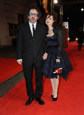 The Alice in Wonderland director with his wife, who returns after winning Supporting Actress last year for The King's Speech to present the BAFTA for Supporting Actor.