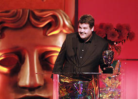 James Corden, BAFTA-winning star of 'Gavin &amp; Stacey', presents the Writer category (pic: BAFTA / Richard Kendal).