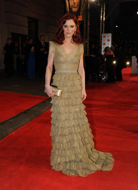 Most recently seen in BBC series Merlin, the actress is perhaps best known for her turn in crime drama Silent Witness, she's pictured here in a gown by Luisa Beccaria. She also wears Protector Citrine earrings and ring, and has Calla Lily orange sapphire broach placed in her hair, all by Asprey.