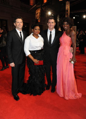 The Help producer Brunson Green, actress Octavia Spencer, director Tate Taylor and actress Viola Davis. The film is nominated for five BAFTAs including Best Film, Leading Actress and Supporting Actress. Davis is wearing a dress by Valentino, shoes by Jimmy Choo and Bvlgari jewellry. Spencer is in a Tadashi Shoji dress.