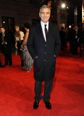 The filmmaker and actor is nominated for two awards: Leading Actor in The Descendants and Adapted Screenplay for The Ides of March. Clooney is wearing Armani.