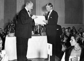 Jack Warner and Hardy Kruger at an Academy event in the Savoy Hotel, March 1959.