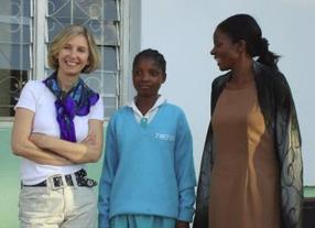 The Rosemary Pencil Foundation President Gillian Rose in Malawi with Gloria, a student at the New Era School for Girls, and Gladys Msonda from Children in the Wilderness.