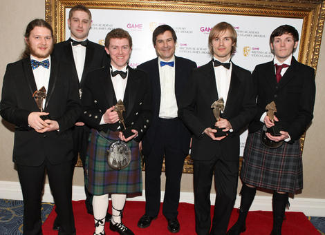 The Butterflyers team display their BAFTA Ones to Watch Award in Association with DARE to be Digital for their innovative platfom game Shrunk! (BAFTA/Steve Butler).