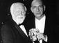 Lord Attenborough presents Sir Ben Kingsley with the Lifetime Achievement Award in 1999.